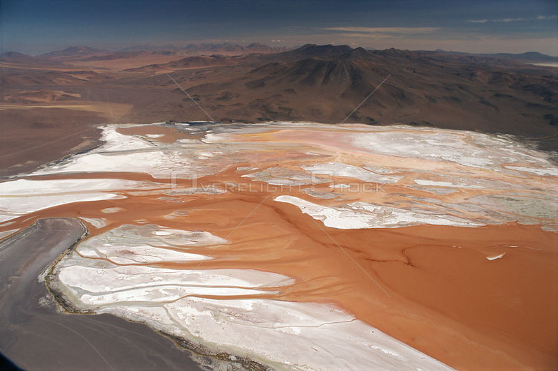 Lago Colorado at 4200 m in Andes, Bolivia. Dinoflagellates (red) and mineral salts (white).