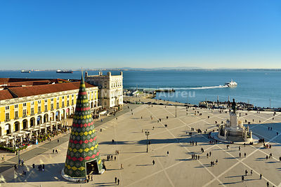 Terreiro do Paço (Praça do Comércio) in the evening with the traditional Christmas Tree, one of the centers of the historic city facing the Tagus river. Lisbon, Portugal