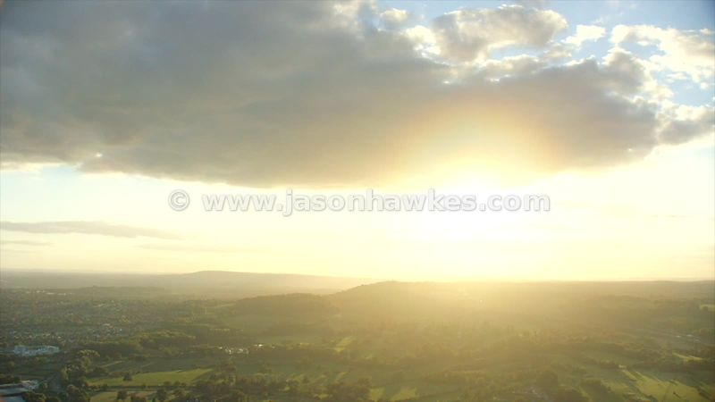 Aerial footage across the countryside at sunset