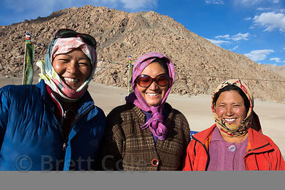 Three ladies from the Himalayan village of Umla wait for a bus home after finishing a shift at an Indian Army construction site, Ladakh, India