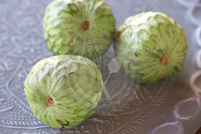 custard fruit on decorative metal tray, close up