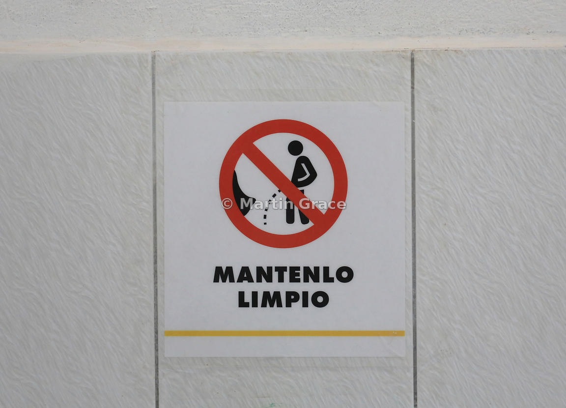 Sign encouraging men to 'Keep It Clean' in toilets, Puerto Ayora, Galapagos. It's a good thing the red diagonal is in just the right place!