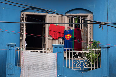 Superman shirt hanging out to dry, Beniatola, Kolkata, India