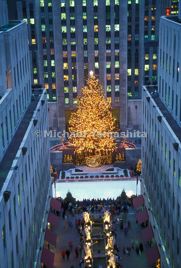 Visiting the Christmas tree and ice skating rink at Rockefeller Center is a holiday ritual for both New Yorkers and tourists.  Manhattan, New York City.
