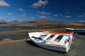 Salinas del Janubio Salt flats and fishing boats near Playa Blanca, Lanzarote, Canary Islands, Spain.
