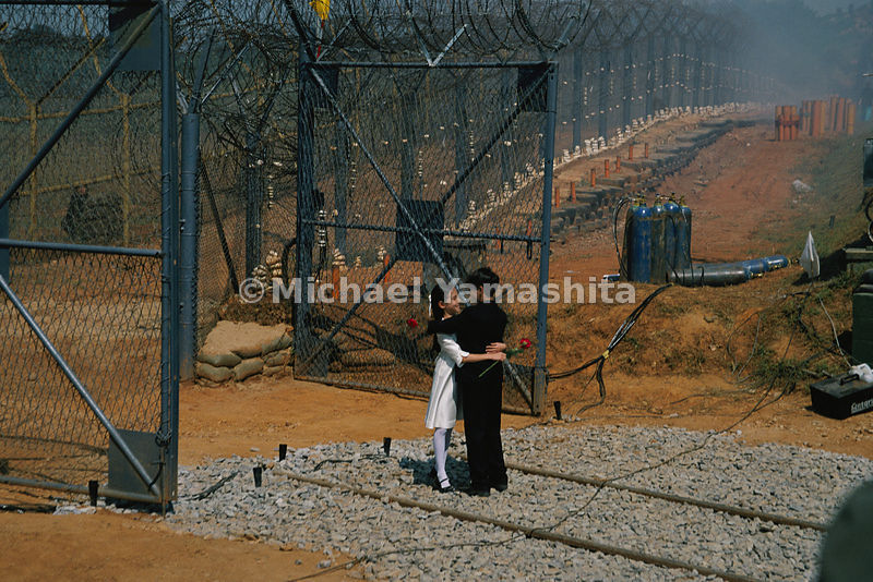 Both North and South Korea recently signed an agreement to reopen two railways across the border. To celebrate the pact, children representing the two Koreas embrace outside the South's DMZ fence.