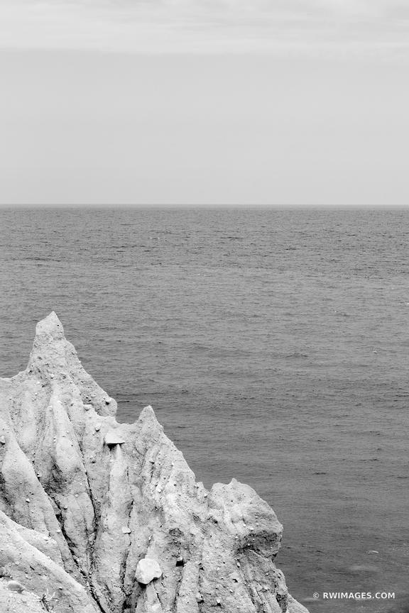 CLIFF ATLANTIC OCEAN MONTAUK POINT LONG ISLAND NEW YORK BLACK AND WHITE VERTICAL