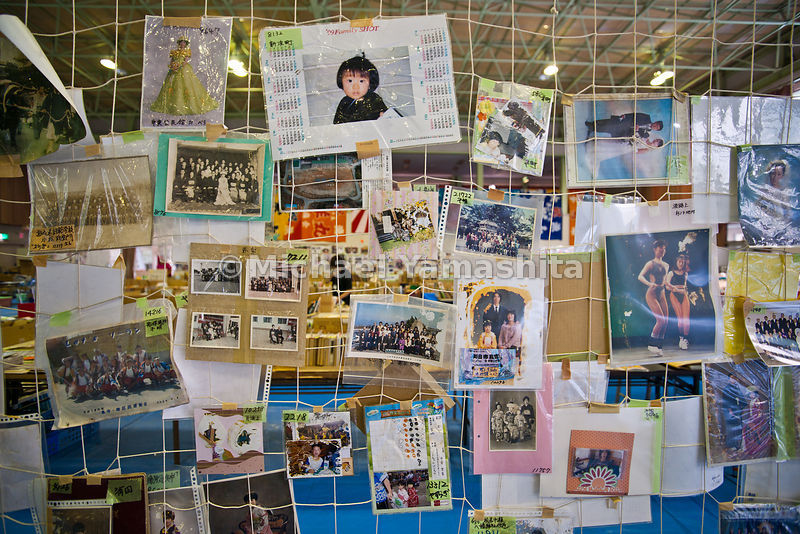 Karakuwa branch , biggest photo Rescue center we've seen. All kingds of memorabilia cleaned and displayed here for claiming by tsunami victims. Organized by place where they were found. 30/day on average come here to search for memories, the only thing they have left after losing all in the tsunami. Buddhist alters, memorial plaques, diplomas, graduation  books all on display. .contact: Shinji Takai 0801661 1383., Kesennuma Reconstruction Assoc. .kcberry.takai@gmail.com