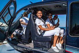 Yacht crew in helicopter