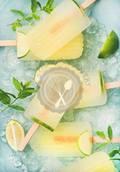 Summer lemonade popsicles with lime and chipped ice, top view