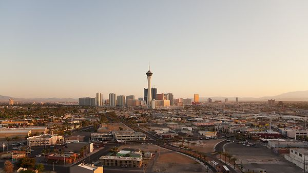 Wide Shot: Sunset Over The Las Vegas Strip, Busy Streets, & Surrounding Neighborhood