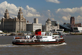 The Mersey ferry sails past the Pier head in Liverpool