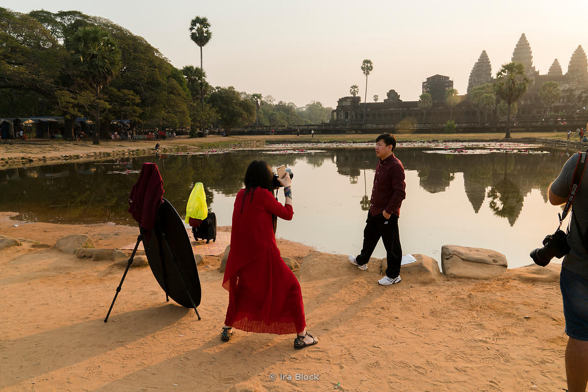 Tourists pose outside Angkor Wat in Siem Reap, Cambodia.