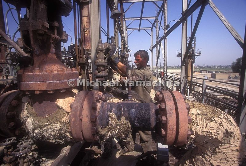 Daura refinery on the outskirts of Baghdad. Built in 1954 by the British and the US oil companies, where 4000 workers produced 20 plus kinds of oil products in this state of the art facility. Today aftter suffering heavy damage in 1991 it's barely operates with original equipment.