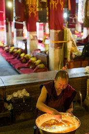 A monk and yak butter candles at Dreprung Monastery in Lhasa, Tibet.