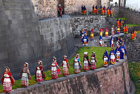 Ñustas / Virgins of the Sun on wall of Coricancha / Sun Temple at start of Inti Raymi festival, Cusco, Peru