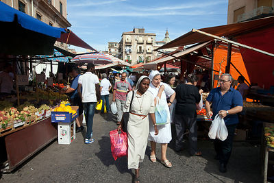 Italy - Palermo - Two nuns walk through the Capo Market with their shopping