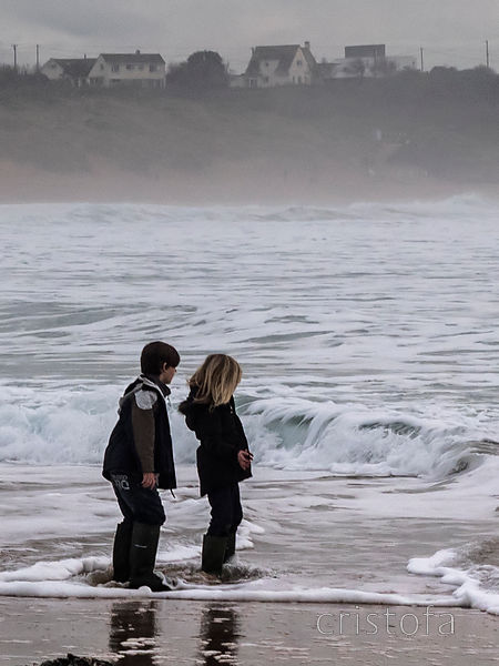 children ponder the waves in Constantine Bay