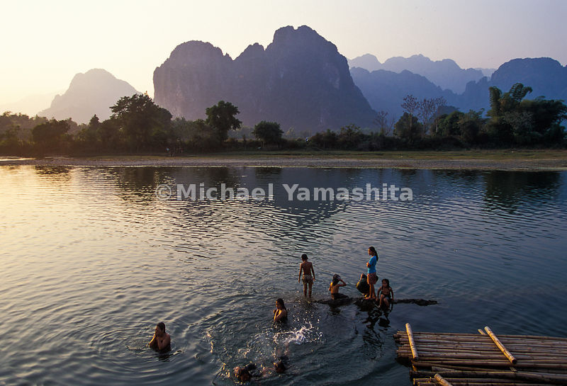 Villagers swim and bath in the Mekong River, Laos