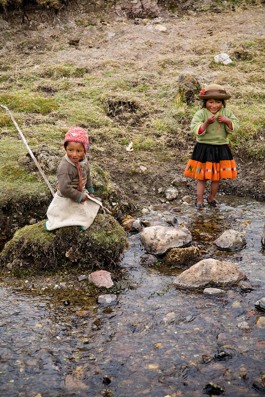 Andean kids splahing in the chilly water, Lares Trek, Andes Mountains, Peru