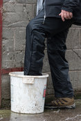 People dipping their boots in a disinfection at a poultry unit as part of Bio-Security Lancashire, UK.