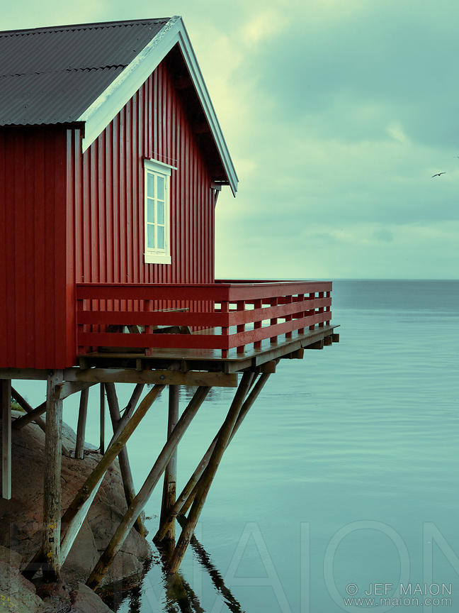 Red wooden house by the sea