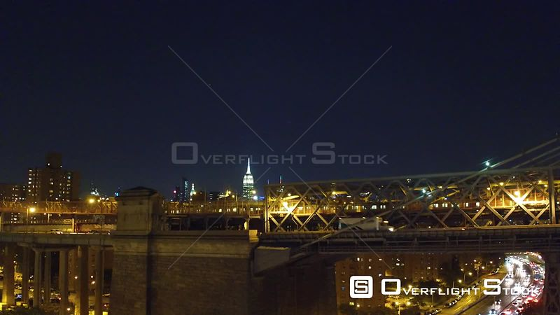 Crisp, cold night rising shot from the south side of the Williamsburg Bride facing north with views of the Empire State and Chrysler Buildings.