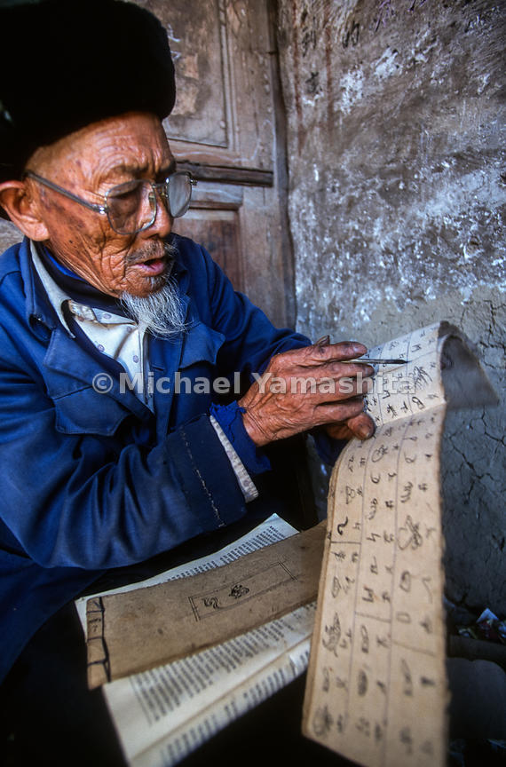 He Zouyi, 82, translates Naxi pictographs. He and National Geographic explorer, Joseph Rock produced Naxi/English dictionary..Xining, Qinghai, CHina