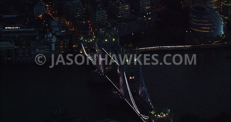 London Aerial Footage of Tower Bridge and River Thames at night.