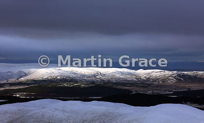 Looking over Strathspey to the sunlit Monadhliath mountains from Cairn Gorm, late afternoon