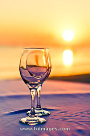 romantic sunset drink with wine glass