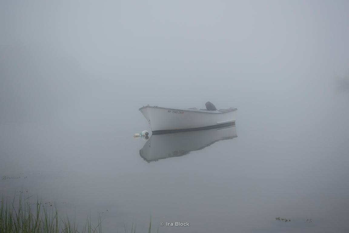 A small boat in the fog on Lake Montauk.