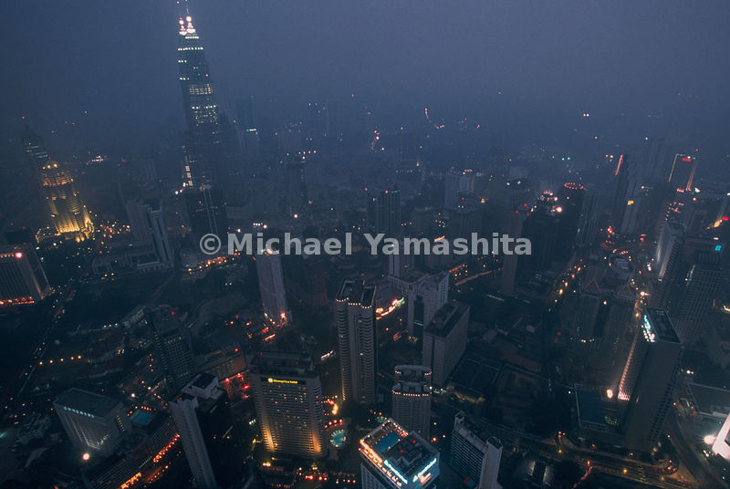 The lofty lights of Kuala Lumpur, the capital of Malaysia, dim under a cloud of smoke blown in from the forests of Borneo and Sumatra, the site of most of Indonesia's unchecked fires. Desperate officials ordered that all high-rise buildings have water sprayed from their heights to dissipate the choking haze. At worst, before rains came in November and doused the fires, the pall spread over eight countries and 75 million people, covering an area larger than Europe.