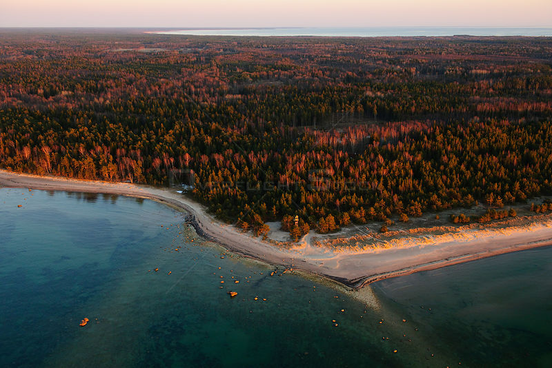 Small headland and watch-tower in lowland forested landscape. Hiiumaa Island, Estonia, Europe, April.