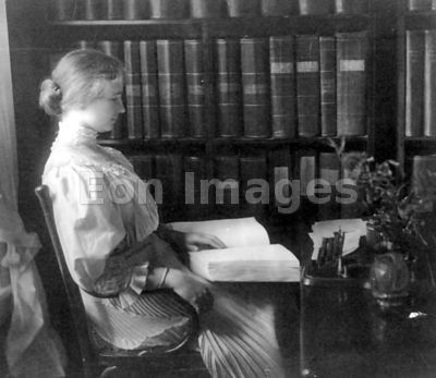 Helen Keller reading book in Braille