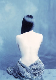 woman's back blue toned