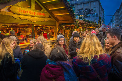 Young People meeting and drinking at the Hamburg Rathausmarkt Christmas Market