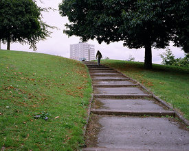 A figure follows the path upwards towards Barry Jackson Tower