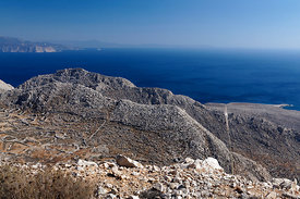 View looking towards Rhodes from the mountains of Chalki Island with the Castle on the mountain top, Dodecanese Islands, Greece.