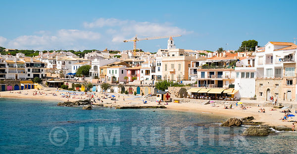 Sunbathers relax on the beach at Calella de Parafrugell, along the Costa Brava, Spain