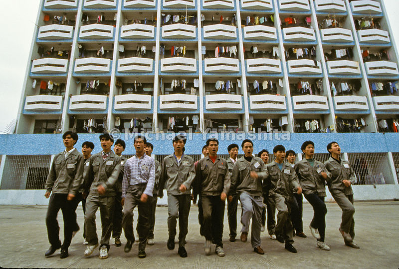 New workers at china bicycle company shout workers anthem during morning morale training