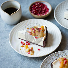 Chocolate Crusted Chèvre Cheesecake with Earl Grey Poached Pears & Pomegranate (gluten-free)