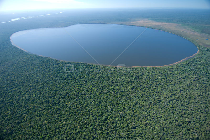 Aerial view of Lake Versalles / El Triunfo surrounded by rainforest, Beni Department, Eastern Bolivia.