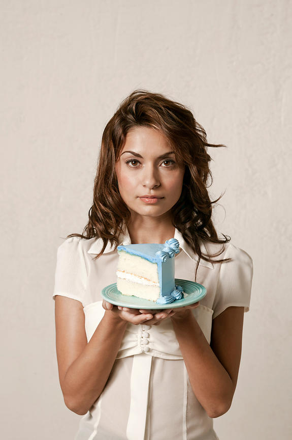 woman holding a slice of cake