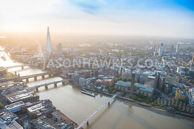 Aerial view of London, River Thames from Millennium Bridge with Southwark Bridge, Cannon Street Railway Bridge and London Bridge.