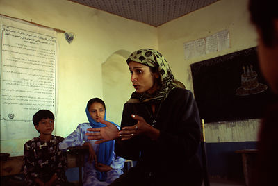 Afghanistan - Mazar-i-Sharif - A teacher adresses schoolgirls in a classroom