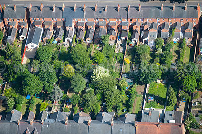 Close up aerial view of street and gardens