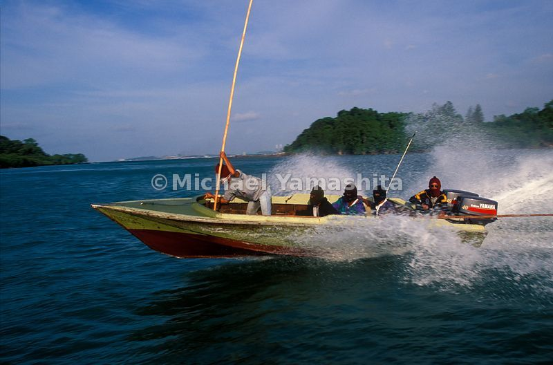 Pirates on their speedboat near the Riau Islands, Indonesia.
