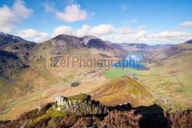 Views of Lake Buttermere and mountain summits of High Crag, High Stile and Red Pike with Gatesgarth Farm in the valley.  Fleetwith Pike, English Lake District.
