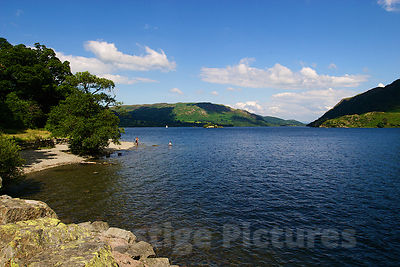 Beautiful Lake on a Summers Day with one Person Swimming in the Distance
